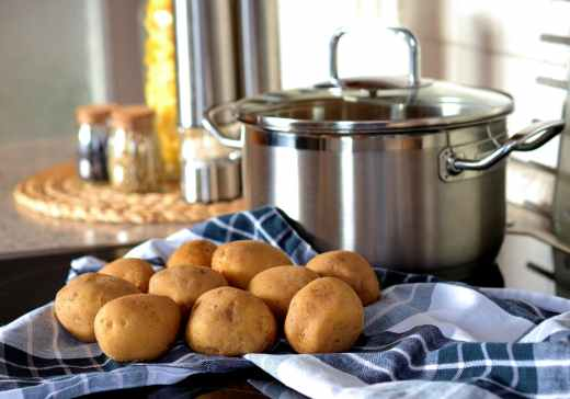potatoes beside stainless steel cooking pot