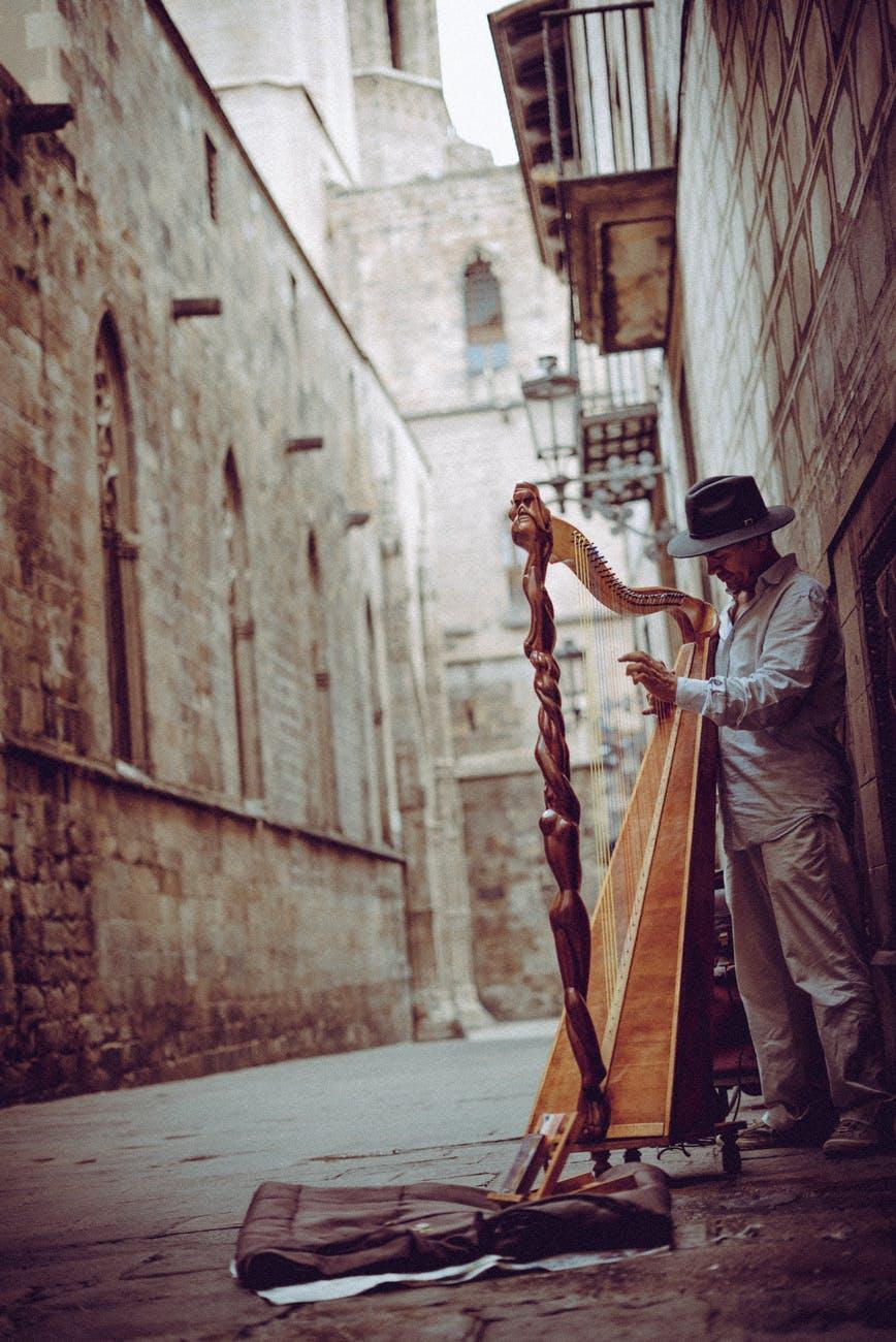 photo of man playing harp